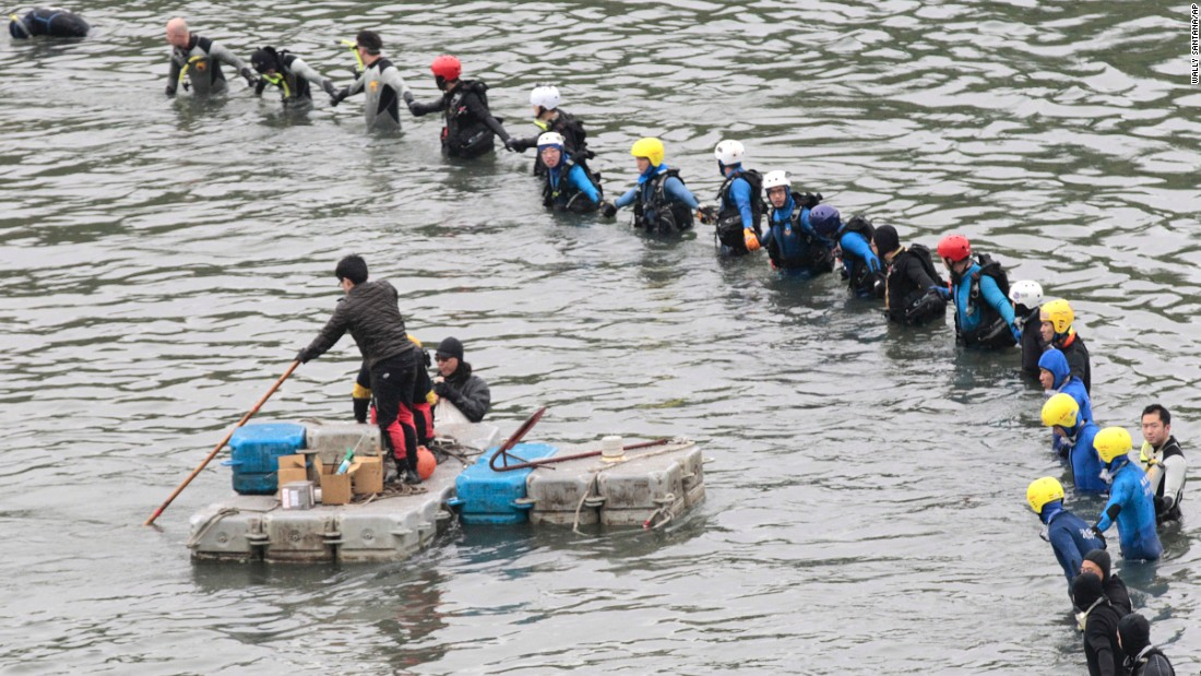 Divers continue search operations at the crash site in Taipei on Friday, February 6.