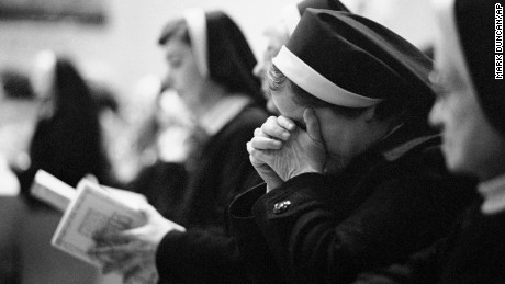 An unidentified Catholic nun holds her head in her hands during the funeral Mass for Sister Dorothy Kazel, the Ursuline nun killed in El Salvador, Dec. 11, 1980 in Cleveland. Burial is set for Thursday in Chardon, Ohio, east of Cleveland.
