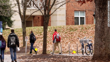 CHARLOTTESVILLE, VA - DECEMBER 6: Students walk through the University of Virginia campus on December 6, 2014 in Charlottesville, Virginia. On Friday, Rolling Stone magazine issued an apology for discrepencies that were published in an article regarding the alleged gang rape of a University of Virginia student by members of the Phi Kappa Psi fraternity. (Photo by Jay Paul/Getty Images)