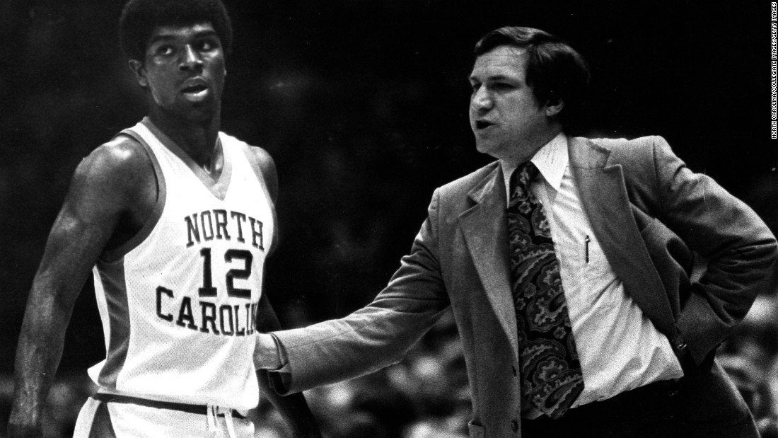 Smith gives final instructions to Phil Ford before sending him back on to the court during a game at Carmichael Arena in Chapel Hill, North Carolina. Ford is one of dozens of players to go on to the NBA after playing under Smith.