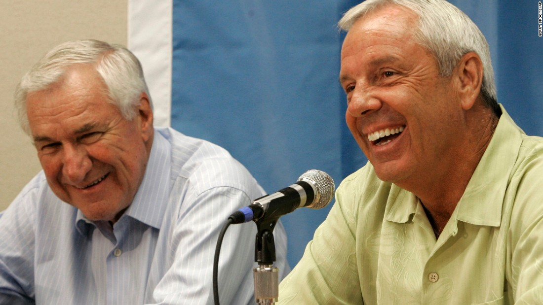 "Smith and Roy Williams smile during a 2007 news conference in Chapel Hill, North Carolina. Upon his mentor's death, Williams said everything he has done at UNC ""is driven by my desire to make Coach Smith proud."""