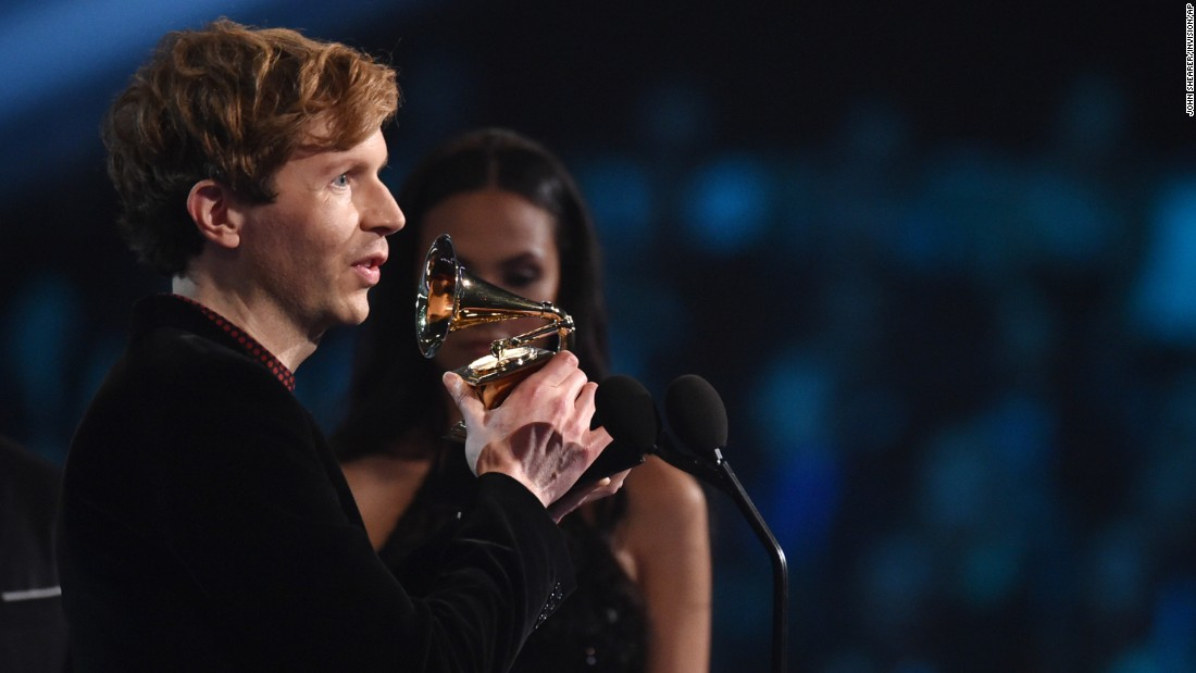 "Beck receives the Grammy for Best Rock Album. His ""Morning Phase"" was also named Album of the Year."