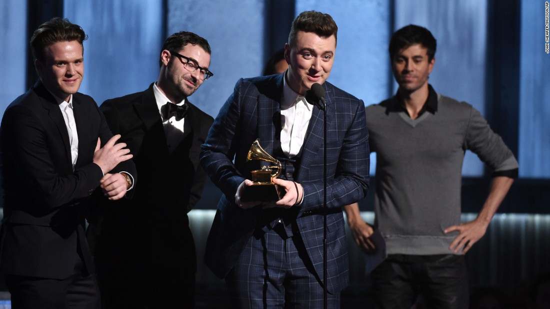 "Sam Smith accepts the Song of the Year Grammy for ""Stay With Me"" at the 57th annual Grammy Awards on Sunday, February 8. Smith also won Record of the Year (""Stay With Me""), Best Pop Vocal Album (""In the Lonely Hour"") and Best New Artist."