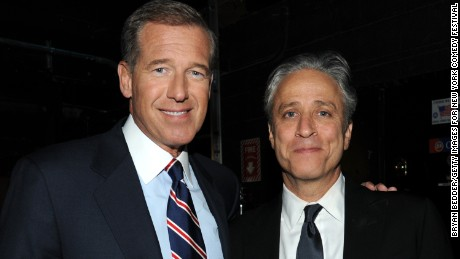 Caption:NEW YORK, NY - NOVEMBER 06: Brian Williams and Jon Stewart backstage at The New York Comedy Festival And The Bob Woodruff Foundation Present The 7th Annual Stand Up For Heroes Event at The Theater at Madison Square Garden on November 6, 2013 in New York City. (Photo by Bryan Bedder/Getty Images for New York Comedy Festival)