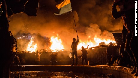 Anti-government protesters guard the perimeter of Maidan Square on February 19, 2014 in Kiev, Ukraine.