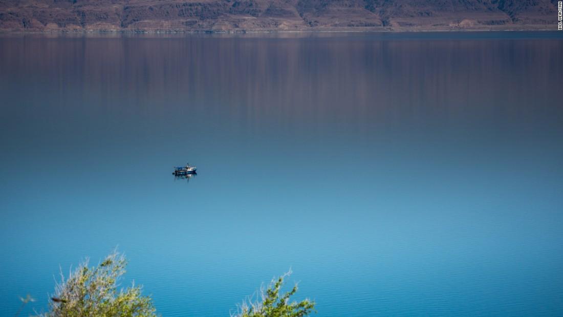 A lone ship navigates the still waters of the Dead Sea near Ein Fasha.