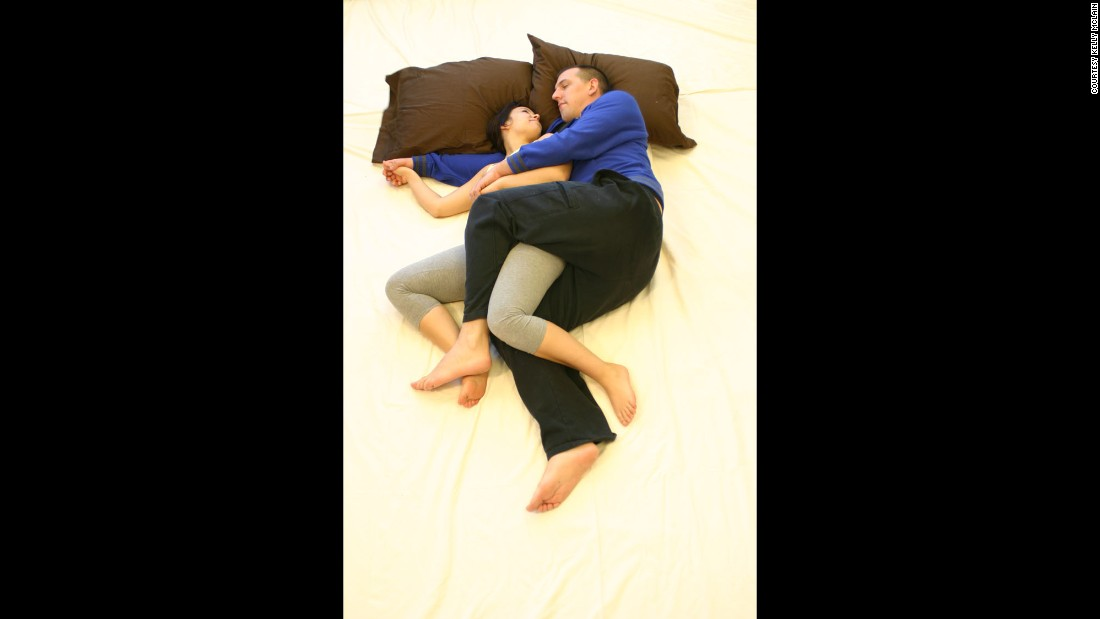 "A hybrid of the classic ""spooning"" method, this position allows for room to touch and talk. To recreate the position, start with a basic spoon and then bend legs as though riding a bike, intertwining arms and legs."