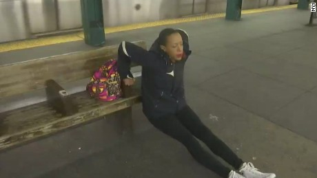 pkg new york woman exercises on subway_00003430