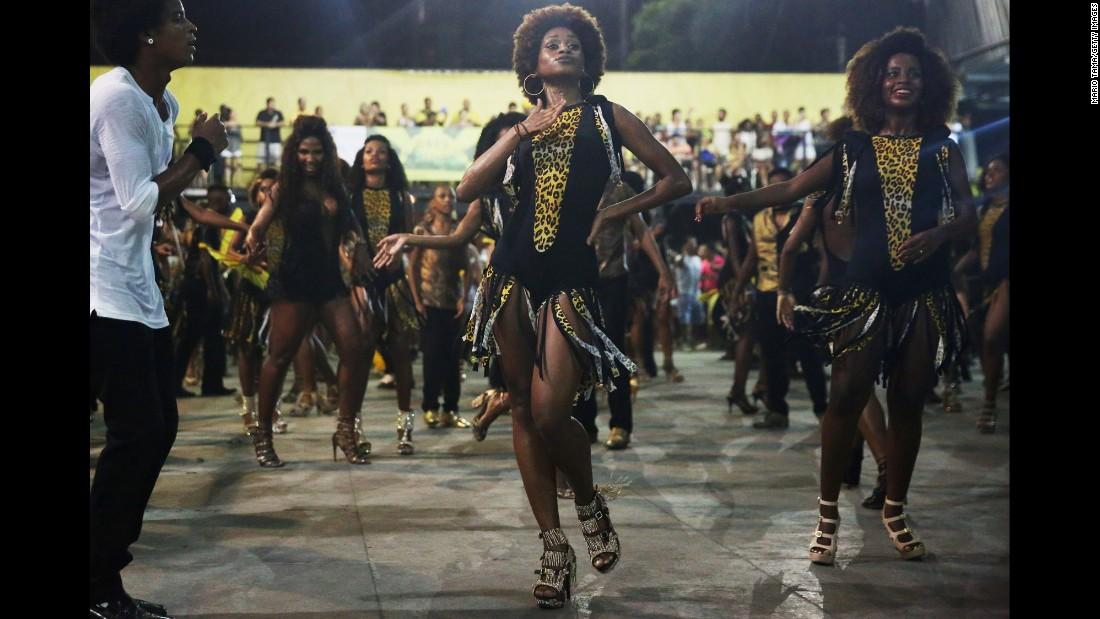 Samba dancers rehearse Tuesday, February 10, ahead of Carnival celebrations in Rio de Janeiro.