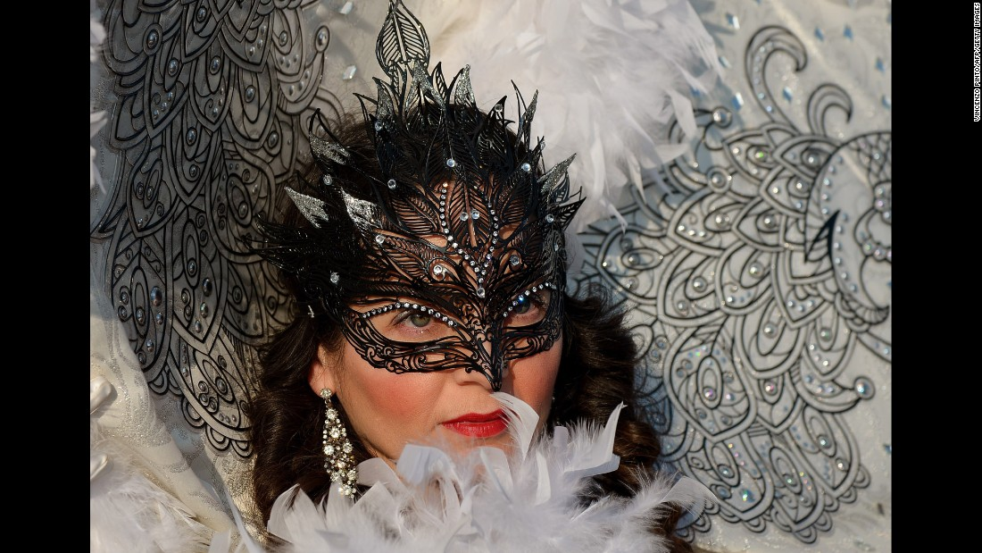 A costumed reveler poses at St. Mark's Square in Venice, Italy, during the Venice Carnival on Sunday, February 8.