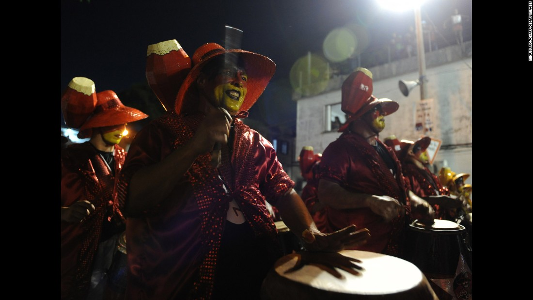"Drummers perform February 5 during the first day of the ""Llamadas,"" one of the Carnival parades in Montevideo, Uruguay."