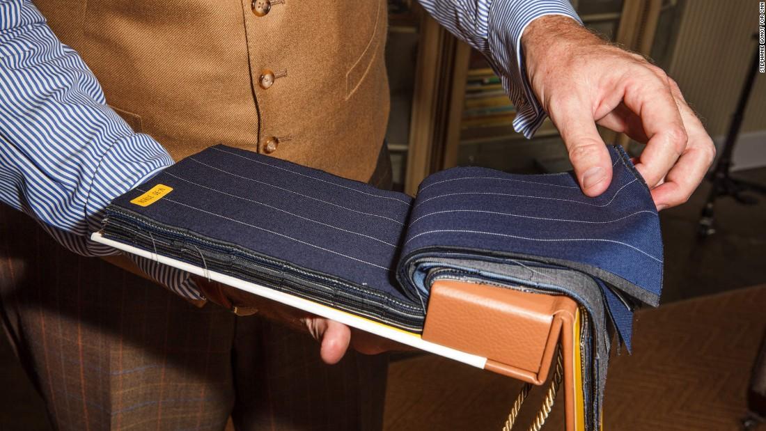 Behr flips through a few fabric options.