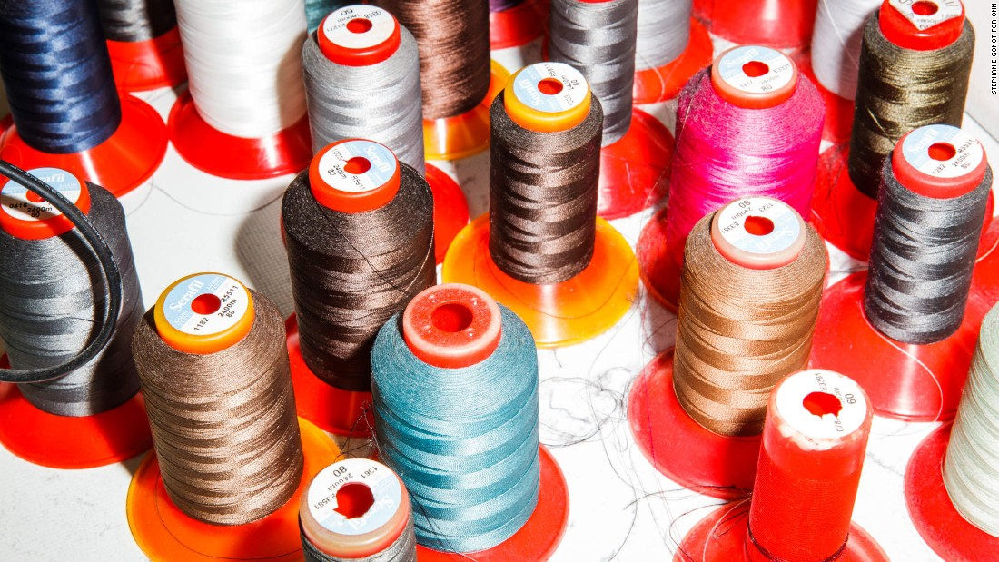 Spools of thread dot the production room at the back of the shop.