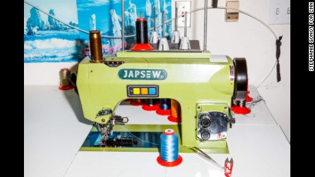 A vibrant sewing machine in Johnathan Behr's Los Angeles tailoring shop.