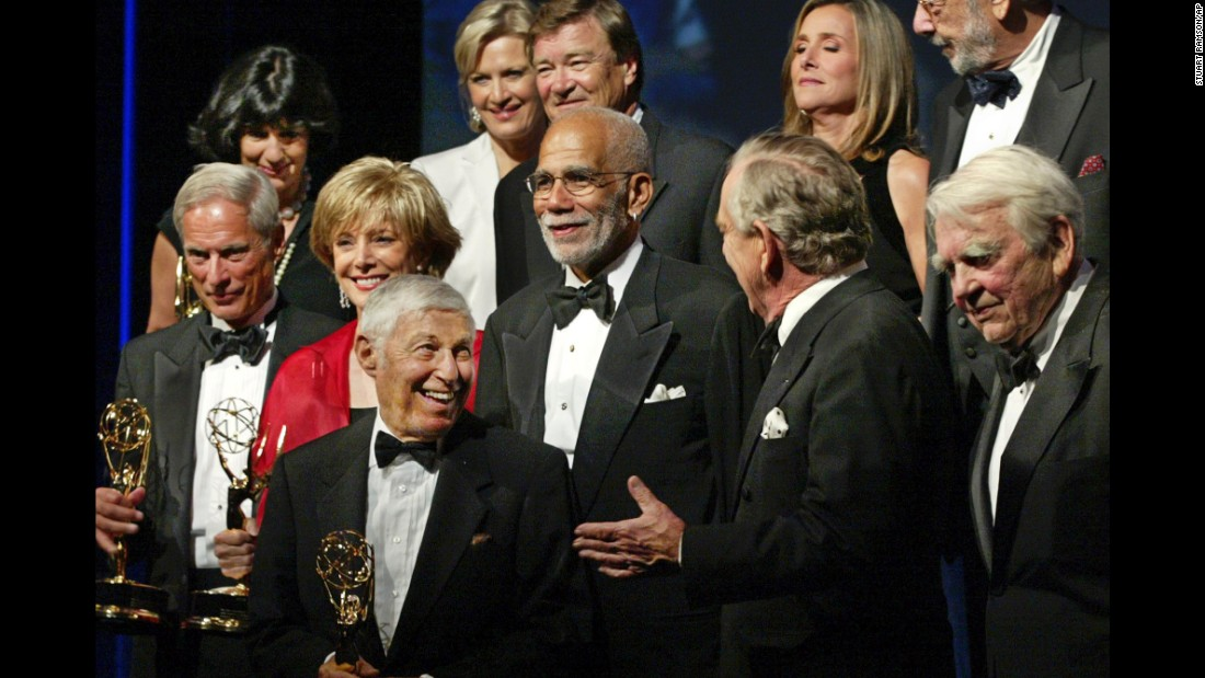 "Simon, far left, with other correspondents of ""60 Minutes,"" and Don Hewitt, the executive producer, lower left, at the annual News and Documentary Emmy Awards in 2003. Next to Simon are Lesley Stahl, Ed Bradley, Morley Safer and Andy Rooney. In the back are, Christiane Amanpour, Diane Sawyer, Steve Kroft, Meredith Vieira and executive editor Philip Scheffler."