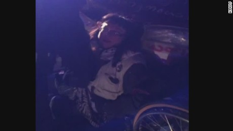 dnt Ferguson chalk graffiti protester wheelchair _00005407