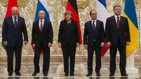 From the left : Belarusian President Alexander Lukashenko, Russian President Vladimir Putin, German Chancellor Angela Merkel, French President Francois Hollande, and Ukrainian President Petro Poroshenko pose for a photo during a time-break in their peace talks in Minsk, Belarus, Wednesday, Feb. 11, 2015. Leaders of Russia, Ukraine, France and Germany are gathering for crucial talks in the hope of negotiating an end fighting between Russia-backed separatist and government forces in eastern Ukraine.  (AP Photo/Alexander Zemlianichenko, Pool)
