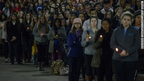 People listen during the vigil at UNC Chapel Hill on February 11.