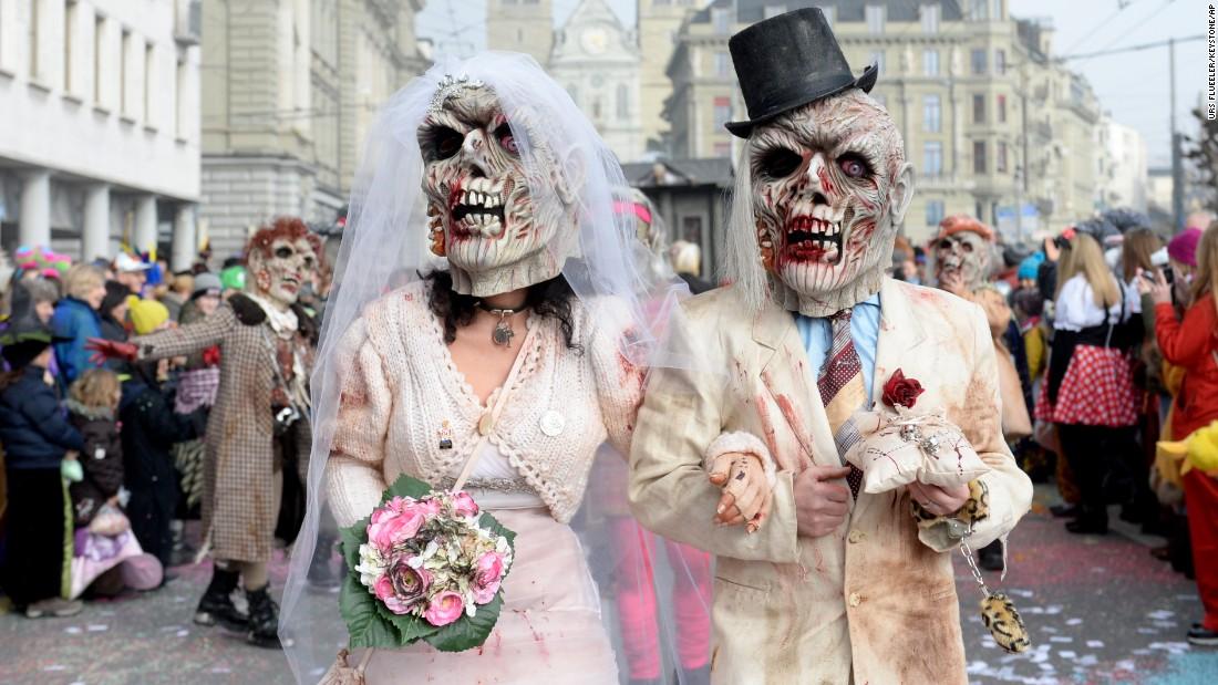 Masked revelers parade through the streets of Lucerne, Switzerland, on February 12.