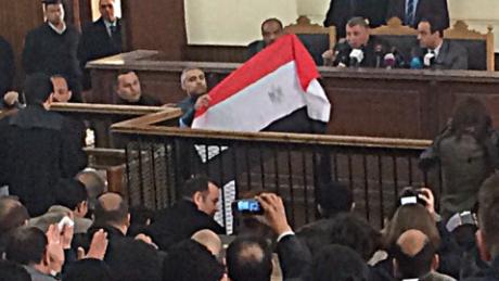 Al Jazeera journalists freed in Egypt pending retrial