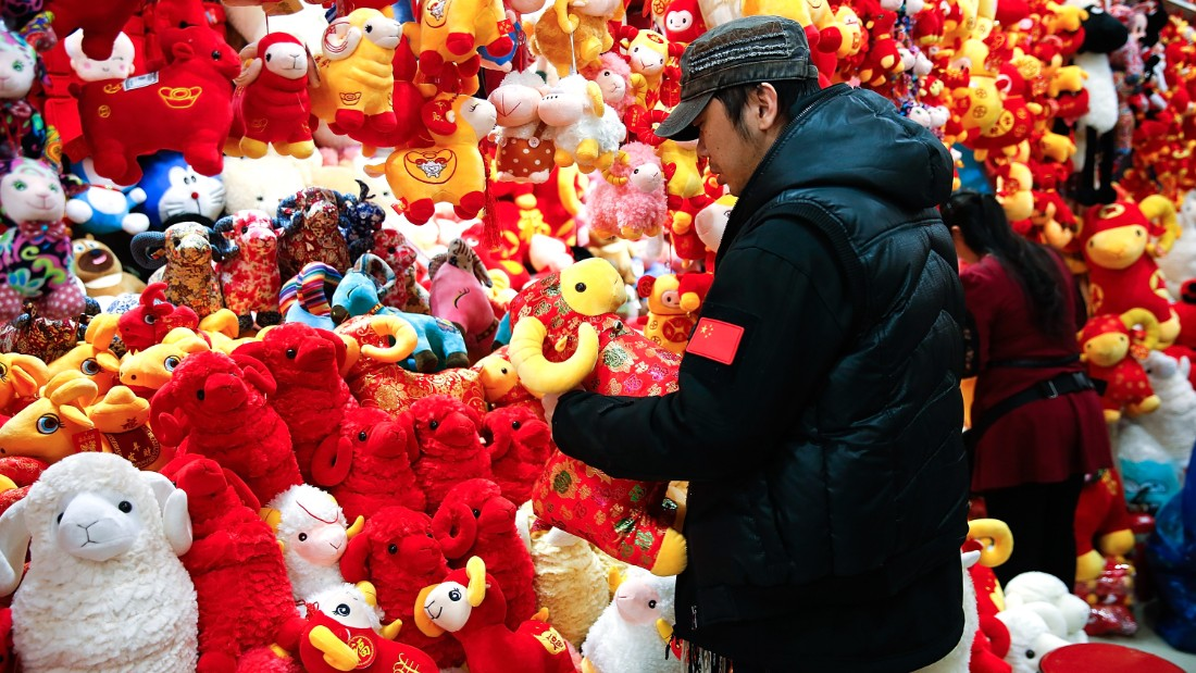 Shoppers in Beijing buy holiday decorations Thursday, February 12, as the Lunar New Year, a massive celebration in many Asian countries, quickly approached.
