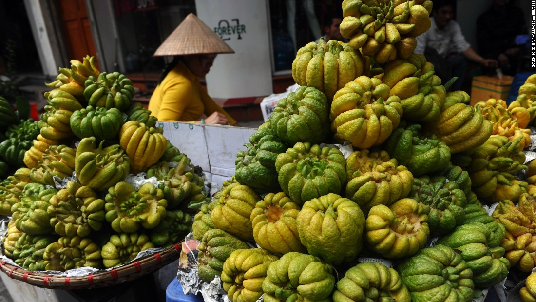 "A woman sells ""Buddha hand"" fruits for Tet, or Vietnamese Lunar New Year, in downtown Hanoi, Vietnam, on February 12."