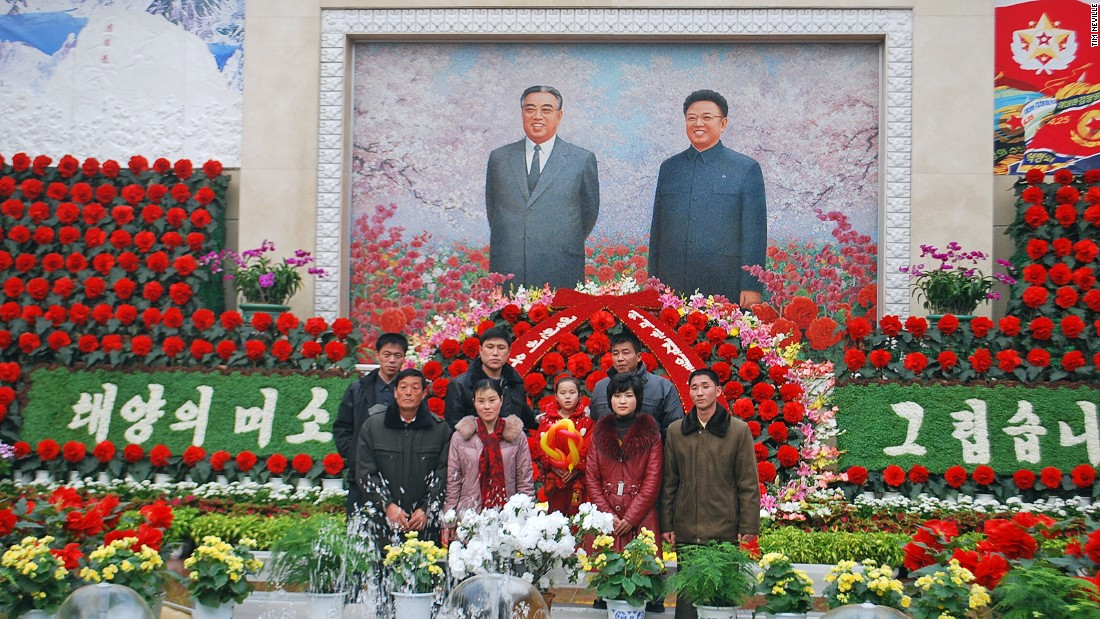 Families frequently pose for photos with the portrait of regime founder Kim Il Sung (left) and his son, Kim Jong Il (right) at a flower show in Pyongyang celebrating Kim Jong Il's birthday. Commemorated in similar fashion, the birthday of Kim Il Sung is known as the Day of the Sun and falls on April 15.