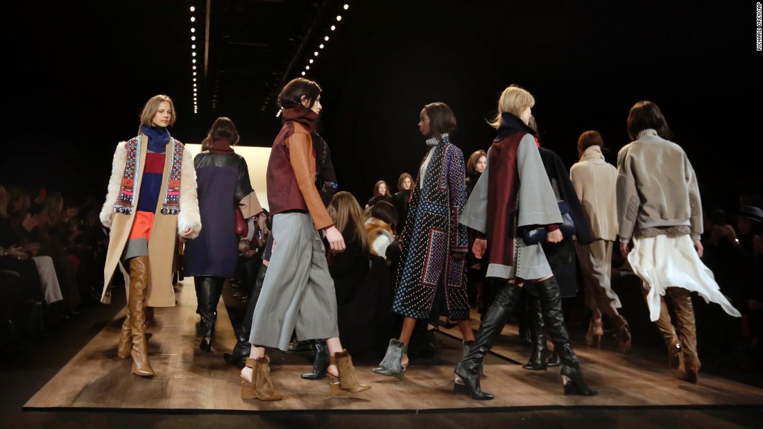 Models in over-the-knee boots, statement coats and cozy knits walk the finale of the BCBG Max Azria show on the first day of the event.