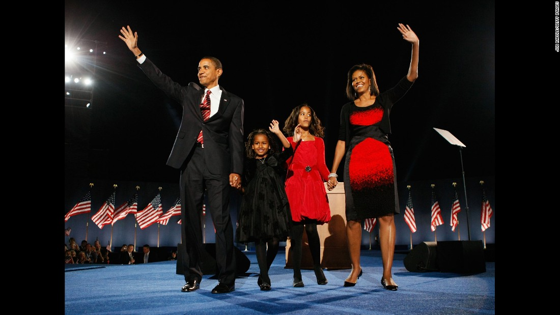 Obama stands on stage in Chicago with his family after winning the presidential election on November 4, 2008.