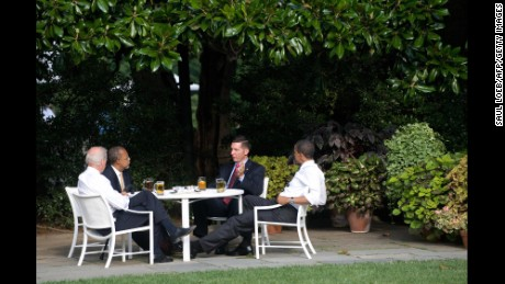 Police Sergeant James Crowley, second right, of Cambridge, Massachusetts, speaks with Harvard Professor Henry Louis Gates Jr., second left, alongside Obama and Biden as they share beers on the South Lawn of the White House in July 2009.