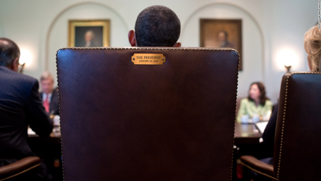 "Obama sits in his chair during a Cabinet meeting in July 2012. This image was tweeted by his official Twitter account in August 2012 in response to <a href=""http://www.cnn.com/2012/08/31/politics/eastwood-speech/"" target=""_blank"">Clint Eastwood's ""empty chair"" speech</a> at the Republican National Convention. The tweet simply said, ""This seat's taken."""