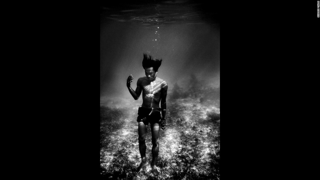 A Badjao man is photographed underwater in Mabul, a small island off the coast of Malaysia. The Badjao are a stateless people with no nationality in the traditional sense, residing instead in boats and living off the sea.