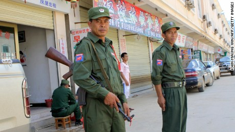 Ethnic Kokang soldiers stand guard in the Myanmar-China border town of Laukkai in 2009.