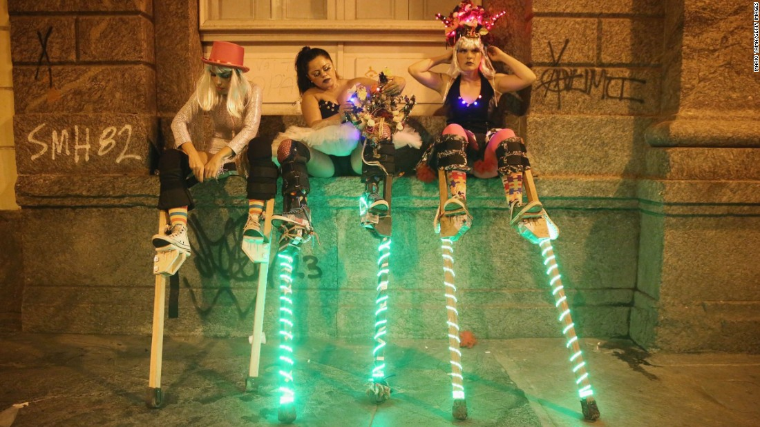 Stilt walkers prepare to perform in Rio de Janeiro on Thursday, February 12.