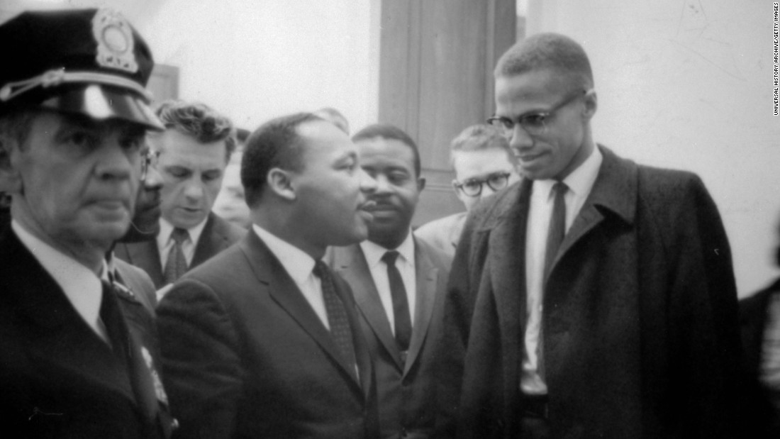 Malcolm X meets with Martin Luther King Jr. in March 1964.