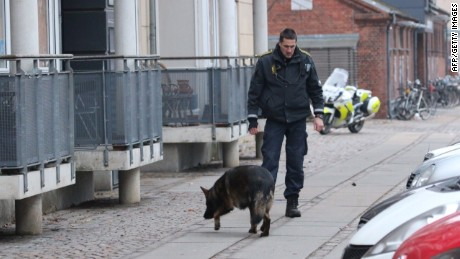 Police secure the area around a building in Copenhagen, Denmark, where shots were fired on February 14 during a panel discussion on free speech.