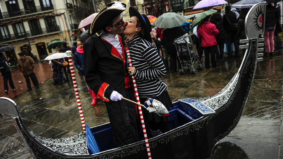 A couple dressed in Venetian costumes kiss in Pamplona, Spain, on February 14.