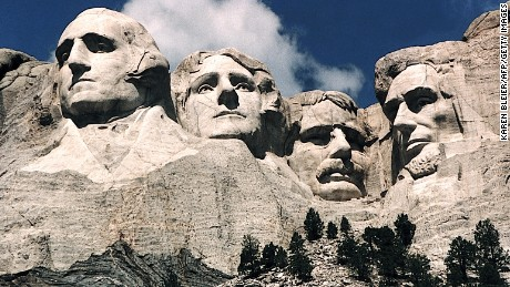 This June 1995 photo shows Mt. Rushmore, in Keystone, South Dakota. Sculptor Gutzon Borglum started work on Mt. Rushmore 10 Aug 1927 and continued for 14 years, but only 6.5 years were actually spent sculpting due to harsh weather delays. The presidents were selected on the basis of what each symbolized. George Washington (L) represents the struggle for independence; Thomas Jefferson (2nd L), the idea of government by the people; Theodore Roosevelt (2nd R), for the 20th century role of the United States in world affairs; and Abraham Lincoln (R) for his ideas on equality and the permanent union of the states. AFP PHOTO/KAREN BLEIER (Photo credit should read KAREN BLEIER/AFP/Getty Images)