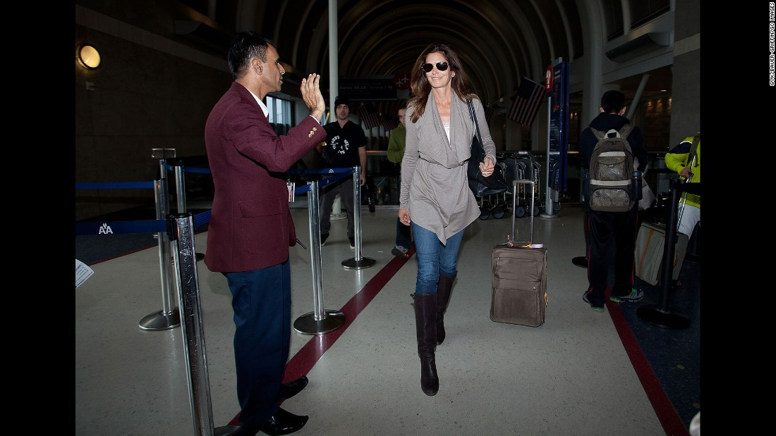 Crawford leaves Los Angeles International Airport in 2012.