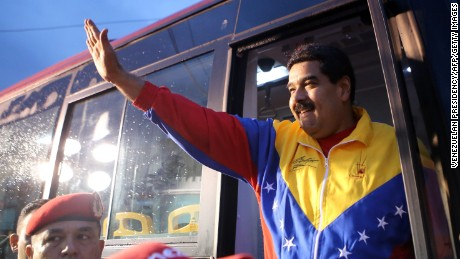 Handout photo released by the Venezuelan Presidency of Venezuelan President Nicolas Maduro waving to supporters during a TV program in Caracas on February 12, 2015. Venezuelan police fired tear gas Thursday to break up students demonstrating against President Nicolas Maduro's government, on the anniversary of protests that eventually left 43 people dead last year.