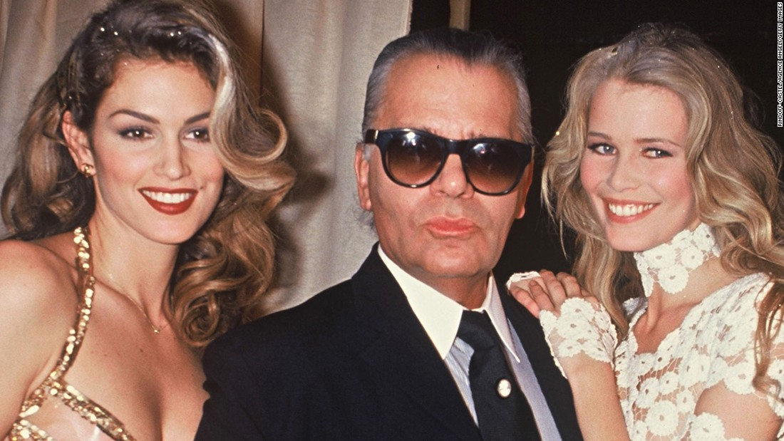 Crawford and supermodel Claudia Schiffer pose with fashion designer ...