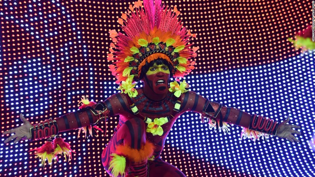 A member of the Salgueiro samba school performs during a Carnival parade February 16 at the Sambadrome in Rio de Janeiro.