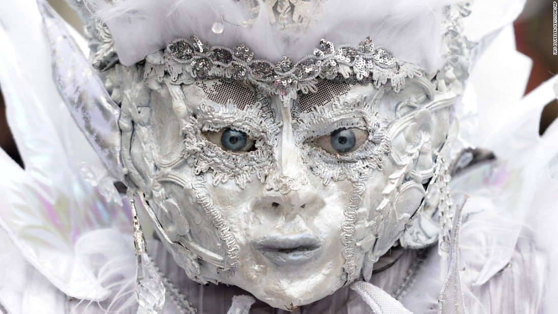 A masked participant walks through the streets in Lucerne, Switzerland, during a Carnival parade on February 16. Carnival is a circus-like celebration that traditionally occurs before Lent.