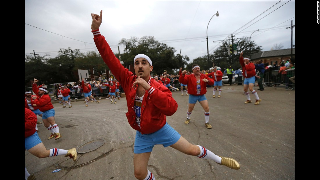 """Members of the all-male dance group """"The 610 Stompers"""" perform during the Krewe of Proteus Mardi Gras parade on February 16."""