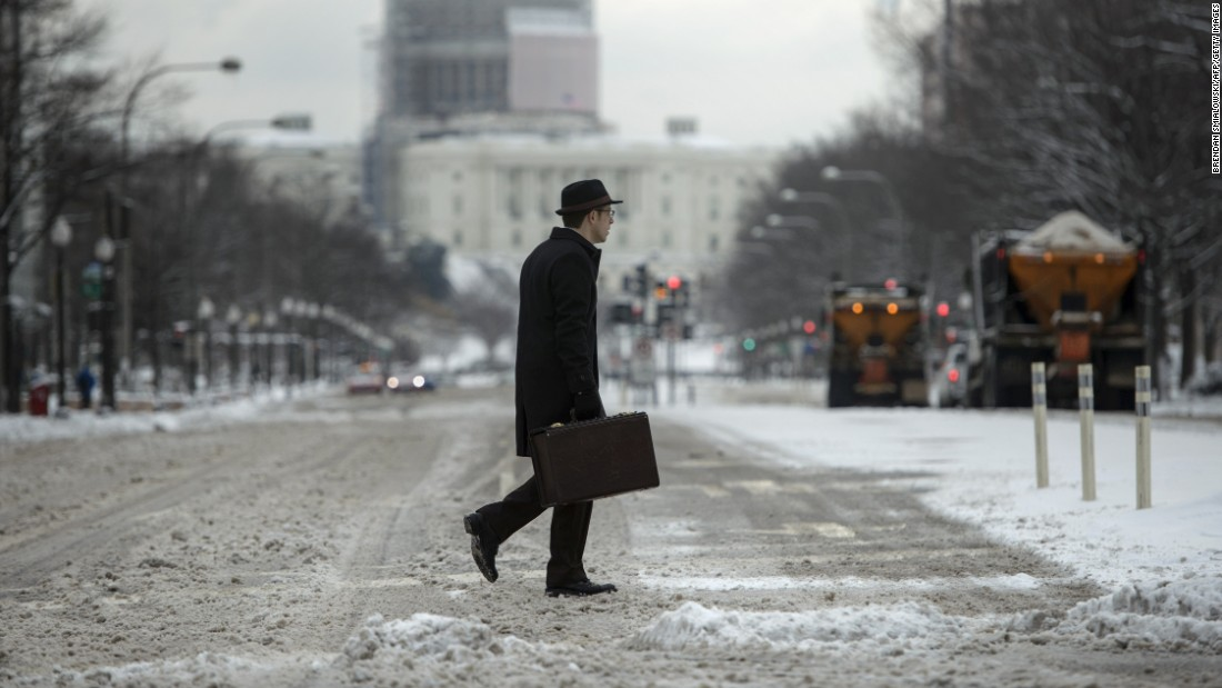 A man crosses a street near the U.S. Capitol in Washington on February 17.