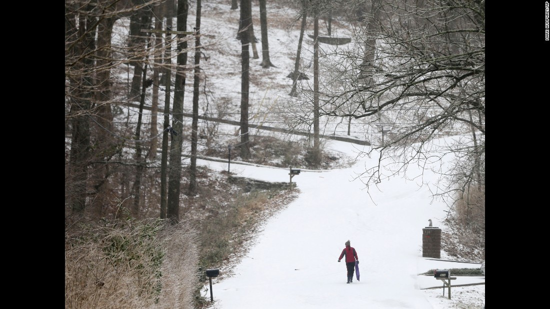 A sledder climbs up a hill in Nashville on February 16.