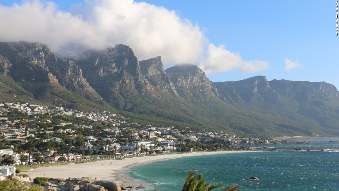 The Twelve Apostles mountains rise above Camps Bay Beach in Camps Bay, South Africa. The beach beauty is No. 11 on the global beaches list.