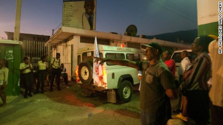 An ambulance carrying injured people arrives at the General Hospital in Port-au-Prince, Haiti, on February 17, 2015.