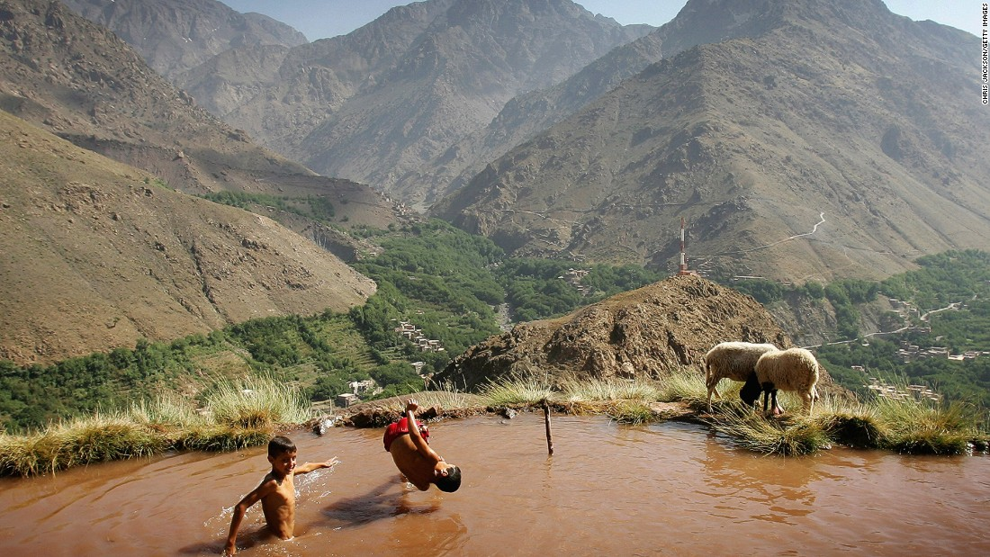 Berber children swim in an irrigation pool on the side of a mountain in the village of Ait Souka near the Imlil district in Morocco. The irrigation pool gradually fills up during the day then is drained in the evening to supply crops and the village.