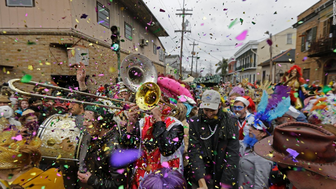 Revelers in New Orleans play brass-band music during a Mardi Gras parade on Tuesday, February 17, 2015.
